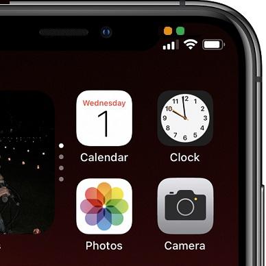 Оранжева точка на iPhone
